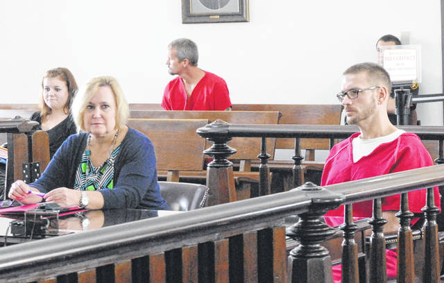Clinton Watson, right, sits in Highland County Common Pleas Court on Wednesday with attorney Kathryn Hapner.