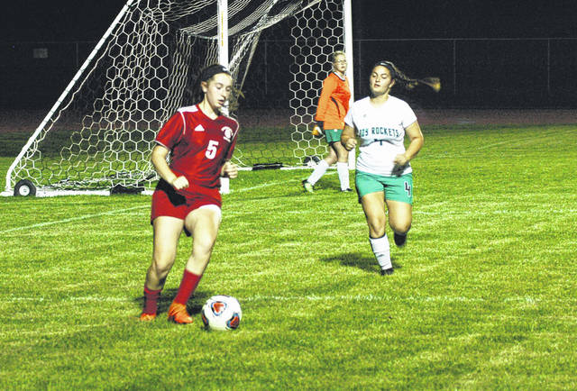 Fairfield's Kylie Fauber corals the ball near the net as she is chased by a Fayetteville defender on Wednesday at Fairfield High School. Fairfield honored senior players from the boys and girls teams in between games on Wednesday.
