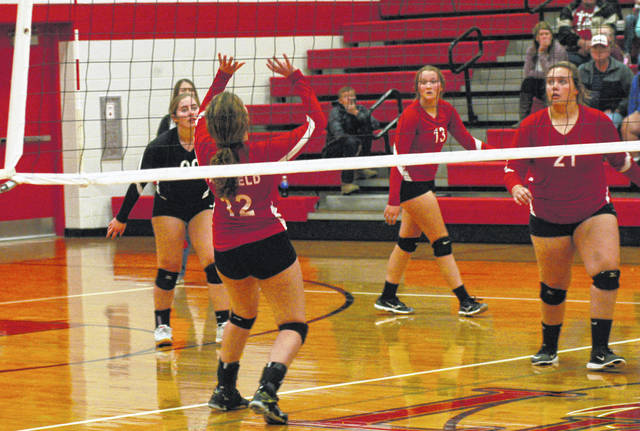 Fairfield's Kami Magee (12) prepares to set the ball as Lauren Arnold (00), Taylor Lawson (21) and Layla Hattan (13) look on Tuesday at Fairfield High School where the Lady Lions took on the Eastern Lady Warriors in sectional tournament volleyball action.