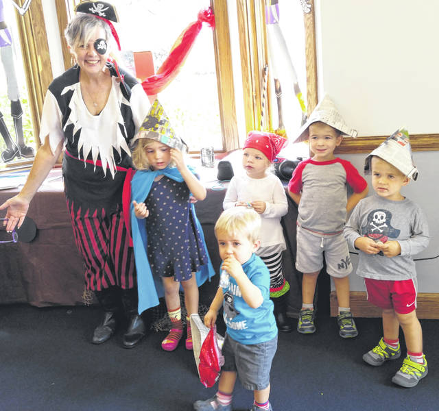 A staff member and vistors enjoy pirate fun during a story time at the Greenfield Branch Library.