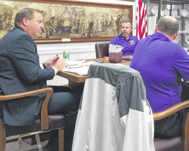 Greenfield Superintendent Joe Wills, left, gives his report at Monday's school board meeting. Also pictured are board president Eric Zint, center, and board member Jason Allison.