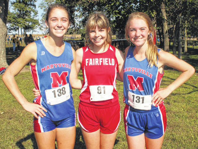 Fairfield's Ciara Colwell (center) is pictured with Jacquelyn Witt (left) and Katherine Krueger (right) of Marysville on Saturday at the Washington Cross the Creek Invitational.