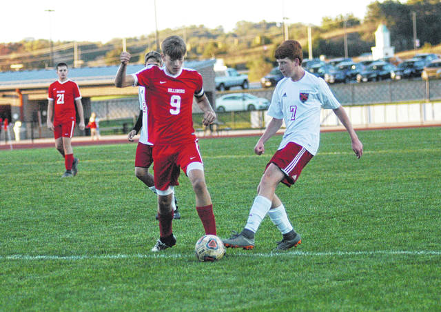 Hillsboro's Quinn Conlon battles for control of the ball with a Circleville defender on Thursday at Hillsboro High School where the Indians took on the Tigers in Southeast District sectional tournament play.