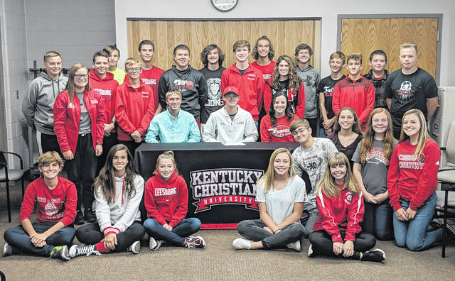 Fairfield's Bennett Hodson (seated center) signed with Kentucky Christian University on Friday, as a cross country and track and field athlete, at Fairfield High School. Hodson is pictured with friends and teammates from the cross country and track and field teams at Fairfield High School.