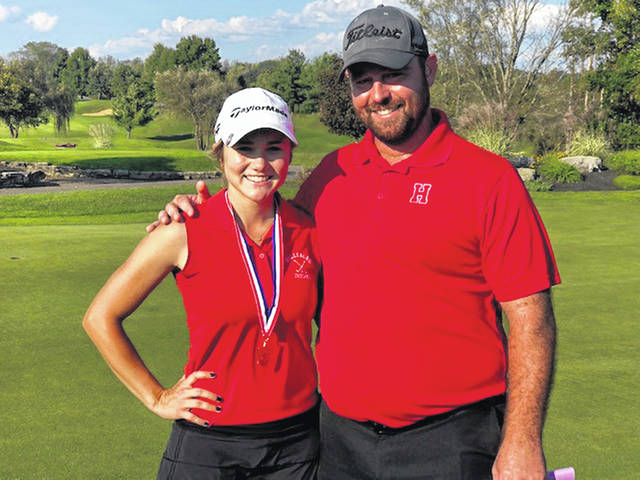 Hillsboro's Kristin Jamieson (left) and Head Coach Nathan Boatman are pictured at Eagle Sticks Golf Club on Monday where Jamieson competed in the D I girls golf district tournament.