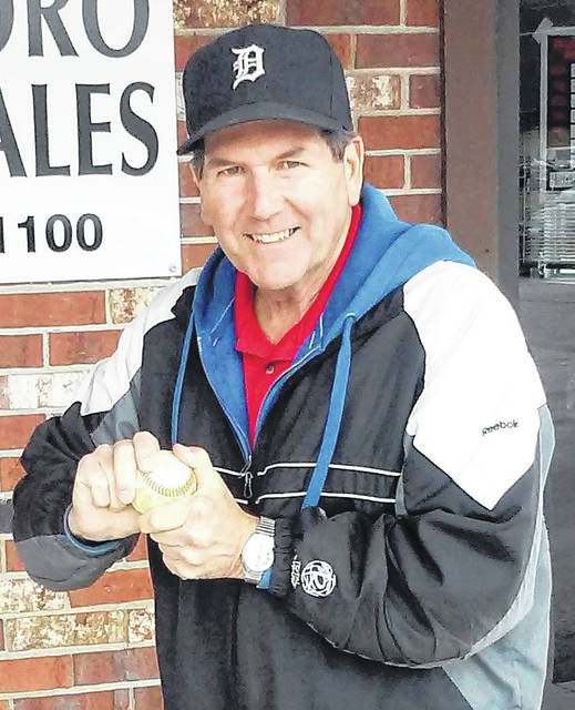 Kip Young, formerly No. 37 for the Detroit Tigers, roughs up the ball for his next sales pitch at Hillsboro Auto Sales.