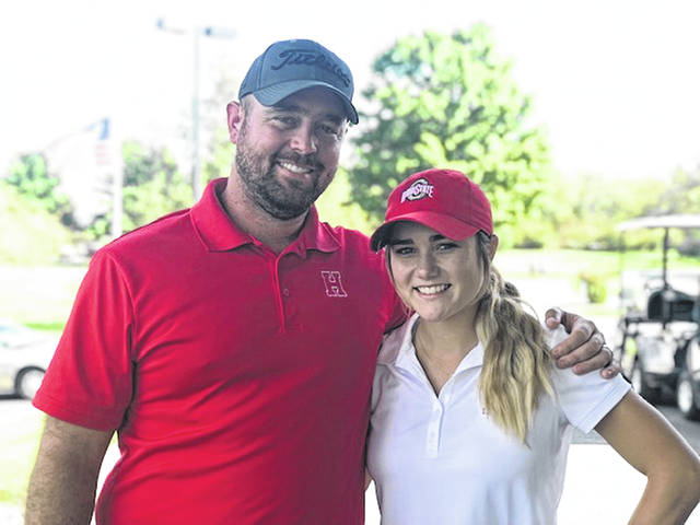 Hillsboro senior Kristin Jamieson is pictured with varsity golf Head Coach Nathan Boatman at Pickaway Country Club where Jamieson won the D I girls golf sectional by seven strokes.