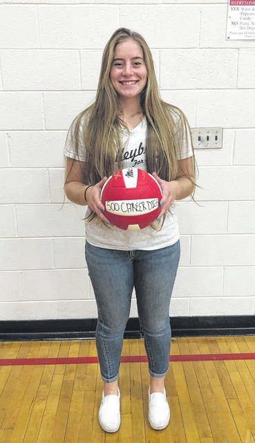 Lauren Arnold is pictured with her game ball commemorating her 500th career dig with the Lady Lions volleyball team.