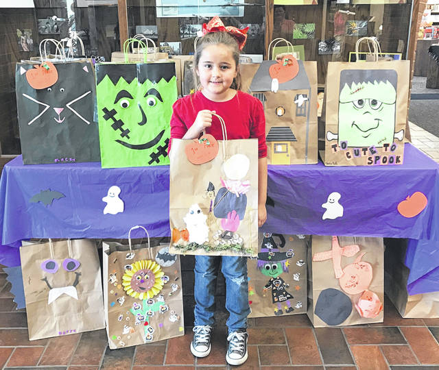 Jenna Jenkins won the 6-9 years age group in the Greenfield Library Halloween Bag Decorating Contest.