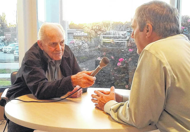 Willard Parr, left, interviews Steve Haag during Tuesday morning's live and final remote broadcast from Jerry Haag Motors in Hillsboro.