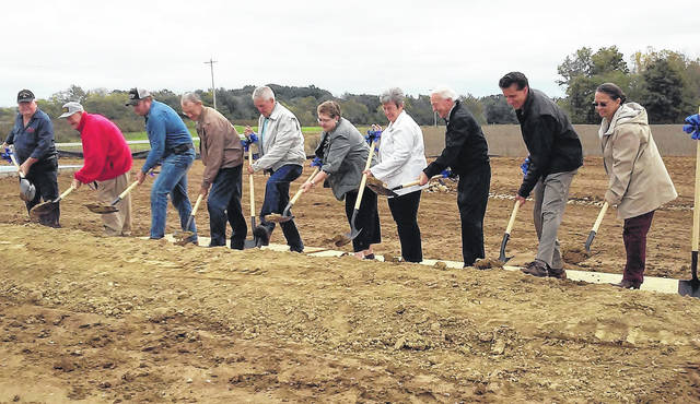 The Highland District Hospital Board of Directors moves the first spades full of dirt at a groundbreaking ceremony on Thursday for the new Rocky Fork Medical Center.