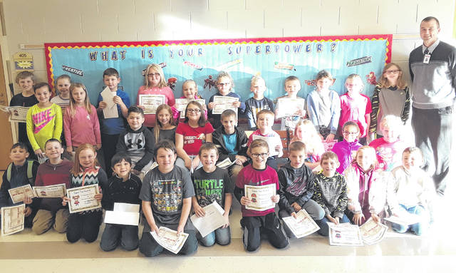 Hillsboro Primary School Principal Jacob Zink is pitcured with his Super Students for the first nine-week grading period of the 2018-19 school year. The students included Jason Herman, Journey Vandemark, Atrayu Frump, Dalton Nicely, Camden Kemper, Hunter Seeling, Madison Burwinkel, Kaylie Willey, Preston Eldridge, Jackson Rudy, Lexi Collins, Andrew Couch, Kinsley Allen, Ann Boyd, Marcus Rhinehimer, Trey Webster, Alayah Rickman, Shyla Baker, Easton Inman, Maverick Adams, Lexi Penrod, Abby Reed, Ava Jones, Collyn Schraw, Elana Kelley, Leland Davis, Kamrie Lee, Izibella Higgenbothem, Erik Remington, Raeden Workman,Lukas Hollon and Boston Sanborn. Not pictured is Ella Jordan.