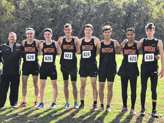 The Whiteoak Wildcats cross country team poses for a picture Saturday at Rio Grande University where the team took part in the D III district cross country race and finished in fifth place to qualify for the regional run. Pictured (l-r): Coach Doug Hughes, Hunter Morgan, Zach DeAtley, Atlee Carr, Logan Cummings, Jacob Campbell, Bryce Bailey, Robbie Raines