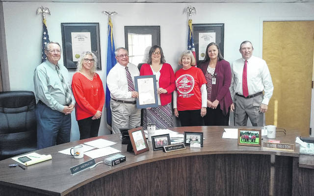 The Highland County Board of Commissioners issue a proclamation declaring Oct. 23-31 Red Ribbon Week in Highland County. Shown from left to right are Commissioner Gary Abernathy, Hillsboro City Schools Counselor Joni Layne, Commissioner Jeff Duncan, Fairfield Local Schools Red Ribbon Coordinator Kevy Jones, Fairfield Local Schools Elementary Library Aid and Red Ribbon Week Co-Coordinator Marilyn Butler, Scioto-Paint Valley Mental Health Center Hillsboro Clinic Director Gena Bates, and Commissioner Terry Britton.