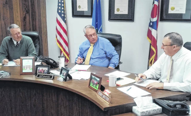 From left, Highland County commissioners Gary Abernathy, Jeff Duncan and Terry Britton discuss business items during their regular Wednesday morning meeting.