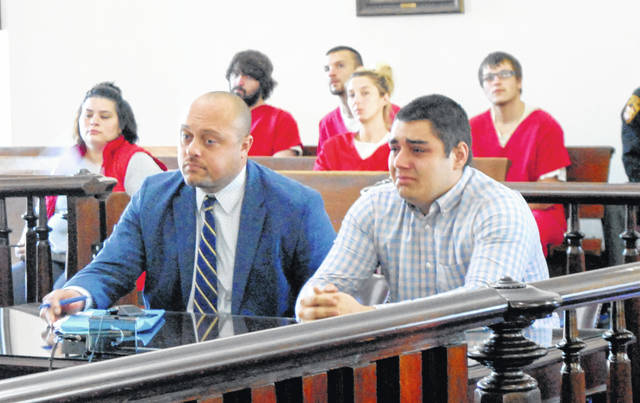 Christian Phelps, right, sits in Highland County Common Pleas Court on Thursday with attorney James M. Calhoun II.