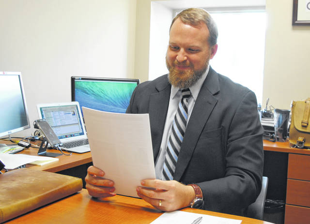 Highland County Health Commissioner Jared Warner reviews Hepatitis A data in his office at the county health department on Monday.