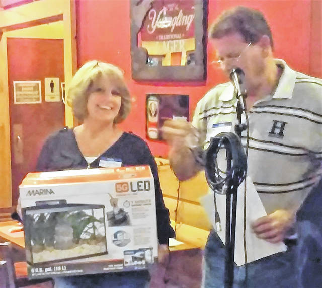 Alley 21 Restaurant and Grille co-owner Pam Bailey and Tim Priest, now with Southern Hills Community Bank, during one of the many prize raffles held Sunday for the benefit of the family of Toby Moore at Alley 21. Bailey told the Times-Gazette that the event raised over $4,000 to help with medical bills and final expenses in connection with the fatal traffic accident that took the life of the two year old on the afternoon of Sept. 16th.