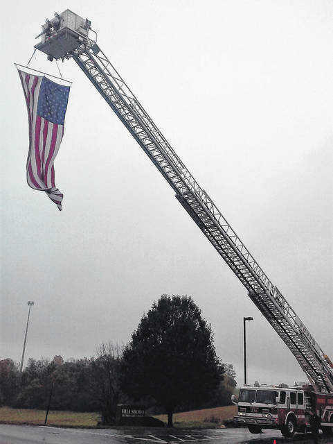 A ladder truck from Paint Creek Joint/EMS Fire District renders the colors for the funeral procession of Highland County Sheriff's Office Cpl. Sandy Frost.