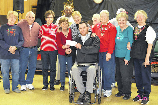 District agent Tyler Ayres of Modern Woodmen of America presents Highland County Senior Citizens Center members with a donation of $2,500 through its matching fund program. The senior center's annual fundraising event, Cookies with Characters, took place Oct. 13 and raised nearly $4,000. Along with Modern Woodmen's matching fund, the total profit of the event was more than $6,200, which benefits the operation of the senior center, a 501(c)(3) non-profit and a non-government organization.