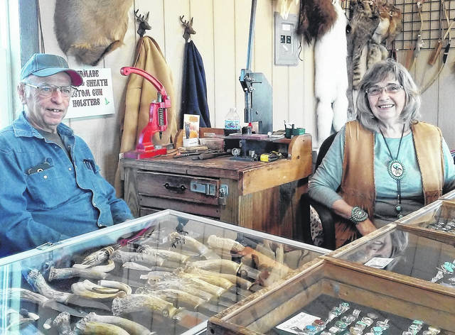 Charles and Bonnie Nace are shown at their newly opened leather goods and Native American jewelry shop near Sugar Tree Ridge.