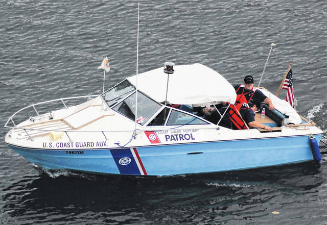 A U.S. Coast Guard Auxiliary patrol boat is shown on duty at Rocky Fork Lake last summer.