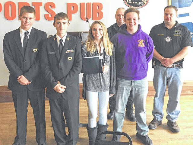 Four members of the McClain Cadet Corps, along with their advisor, were guests Thursday at the weekly meeting of the Greenfield Rotary Club. They are pictured with Greenfield Rotary Club President Andrew Surritt (far right).