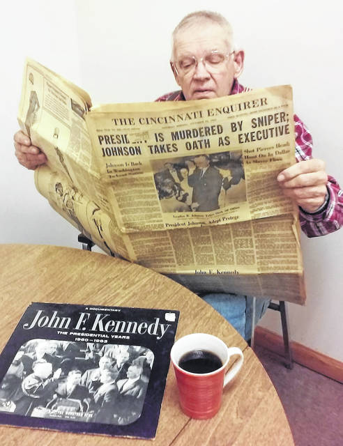 Rocky Fork Lake resident Charles Kerr reads an copy of the Cincinnati Enquirer account of the assassination of President John F. Kennedy. Like most people, he remembered where he was and what he was doing the afternoon of Friday, Nov. 22, 1963.