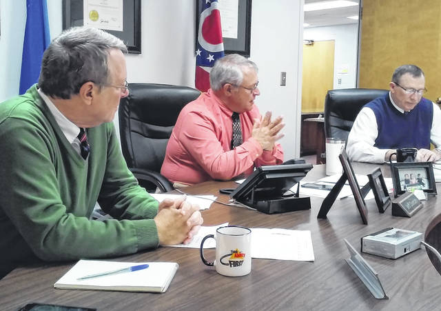 Highland County commissioners Gary Abernathy, Jeff Duncan and Terry Britton discuss matters at hand during Wednesday's regularly scheduled meeting.