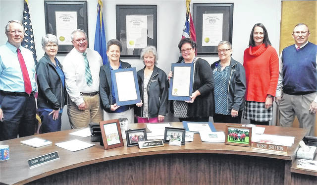 Representatives of Highland District Hospital's Home Health Services receive two proclamations from county commissioners, recognizing Home Care Month and Home Healthcare Aide Week. Pictured, from left, are commissioner Gary Abernathy, Ellen Zink of HDH, commissioner Jeff Duncan, home health aide Cindy Brummet, registered nurse Kathleen Taylor, home health aide Robyn Gleadle, Home Health Services Manager Hazel Smith, commissioner's office clerk Mary Remsing and commissioner Terry Duncan.