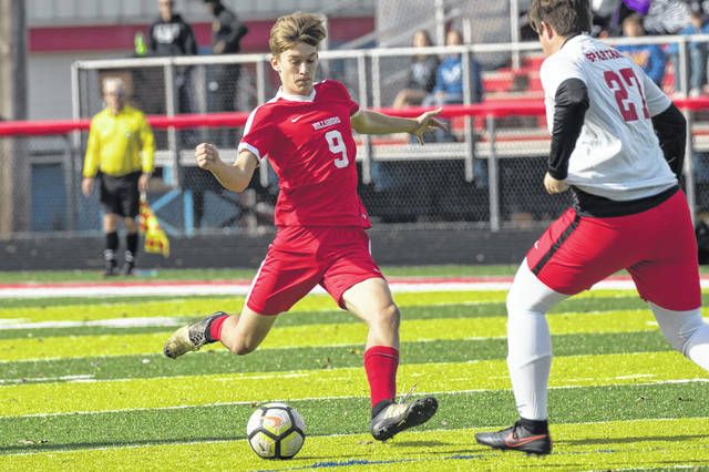 Hillsboro senior Quinn Conlon takes a shot on Sunday at Zane Trace High School in Chillicothe where he took part in the Southeast District boys all star soccer game.