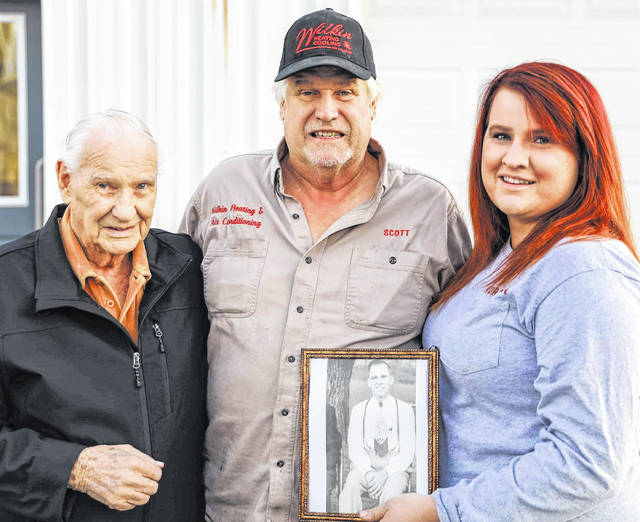 Four generations of the Wilkin family have kept the family business going for 70 years. In the framed picture is the late Paul Wilkin, and shown left to right are Jack Wilkin, who is celebrating his 90th birthday, his son Scott Wilkin, and Scott's daughter, Kurstin Wilkin.