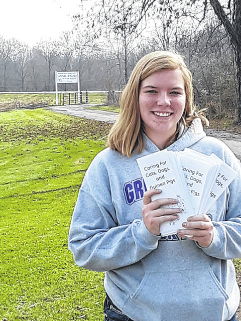 Heather Parker of Greenfield, shown her outside the Highland County Humane Society Animal Shelter on SR 124 east of Hillsboro, recently completed her Gold Award Project — the highest award given to Girl Scouts — by completing a how to care for your dogs, cats and guinea pigs pamphlet. Copies of the pamphlet were given to the Highland County Humane Society and the Fayette County Humane Society to pass out to new pet owners. Parker is a junior at McClain High School and an ambassador with Girl Scout Troop 1382.