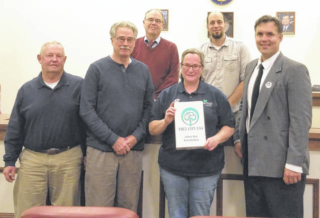 Greenfield Council member Bob Bergstrom, Tree Commission member Ron Coffey, council member Phil Clyburn, Wendi Van Buren, council member Eric Borsini, and City Manager Todd Wilkin are pictured as Greenfield is recognized for its fourth straight Tree City USA distinction.