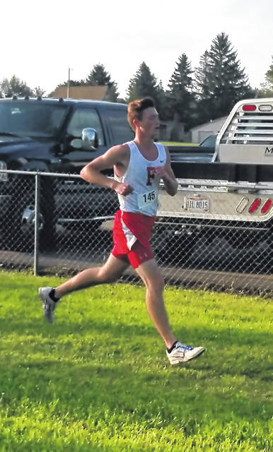This Times-Gazette file photo from August 22 shows Bennett Hodson running at the season opening McClain Invitational in Greenfield at Mitchell Park.