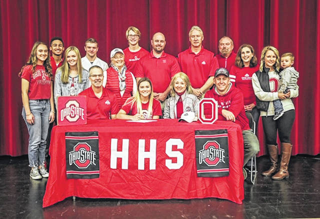 Hillsboro senior Kristin Jamieson signed her national letter of intent for Ohio State womens golf on Tuesday, Nov. 20 at Hillsboro High School. Pictured front row (l to r): David Jamieson, Kristin Jamieson, Jeanine and Jeff Rosselot. Back row (l to r): Kenzie Adams, Chauncey Captain, Johanna Holt, Mason Swayne, Coach Sharon Sims, Brian Shanahan, Coach Nathan Boatman, Coach David Hilliard, Coach Dave Dietrick, Ronda Hilderbran, Jordan Anne and Holten Phillips.
