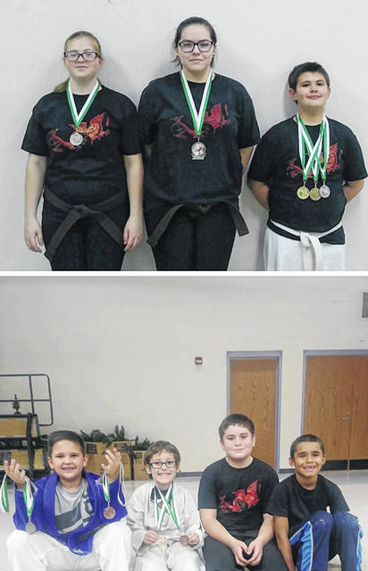 In both photos members of the Cross County Bushido Karate Club pose with medals won at the seventh annual Coats for Kids Karate Tournament at Lynchburg-Clay Elementary School.