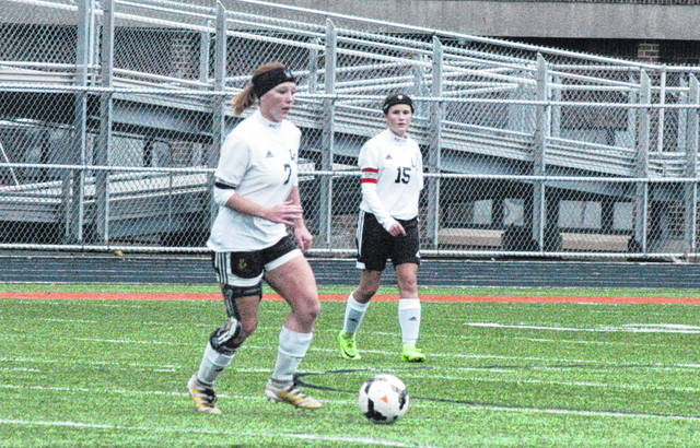 Lynchburg-Clay graduate and current UC Clermont freshman Angela McLaughlin (left) is pictured at Waverly High School during the 2017 D III girls soccer sectional tournament. McLaughlin and the Lady Cougars of UC Clermont won the USCAA D II Women's soccer national championship on Monday in Virginia Beach, VA.