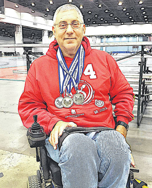 Lee Harris is pictured with the three medals he won at the National Veterans Wheelchair Games in 2017 in Cincinnati. At the 2018 games in Orlando, Fla., the Leesburg area resident won four gold medals.