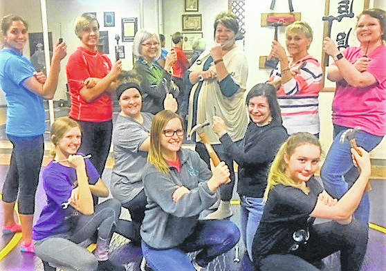 "Pictured are Mel George, Samy Rowe, Katlyn Leeth, Laura Wagner, Deanna Hike, Sarah Wertsbaugh, Loretta Flora, Vicki Fligor, Elaine Head Williams, Carole Martin, Amy Lowe and Cindi Pearce as they practice the ""Rosie the Riveter"" routine for upcoming Greenfield Christmas show ""A Night of Peace."""