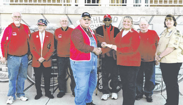 Hillsboro Lions Club President Gary Ames (front, left) presents a check for $10,000 recently to Linda Allen for SATH/KAMP Davetail. Pictured in the back (from left) are Hillsboro Lions Phil McElwee, Bob Parker, Don Edwards, Larry Cole, John Dodds and Sarah Arthur.