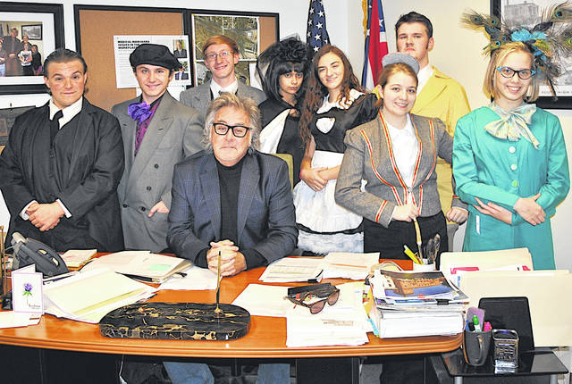 "Members of the Hillsboro High School cast of the play ""Clue"" that will be presented Friday, Saturday and Sunday are shown Wednesday with Hillsboro Mayor Drew Hastings, seated, in his office. The cast members, from left, are Gideon Pickering-Polstra, Duncan Pickering-Polstra, Simon Gabel, Celena Carter, Madeleine Lueders, Aubrey Vance, Michael Ferguson and Nyssa Reno."
