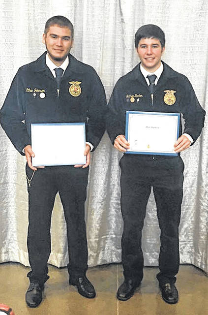 This year at the 91st National FFA Convention and Expo, two former members of the McClain FFA, Mat Barton, right, and Ethan Johnson received their American degrees. The American degree is the highest degree an FFA member can be awarded. This degree shows dedication and leadership throughout a member's chapter and state. To receive an American degree, FFA members must have already received their State FFA Degree, hold active membership for the past three years, complete secondary instruction in an agricultural education program and operate an outstanding supervised agricultural experience program. Members must also show community service, leadership activity, and outstanding scholastic achievement.