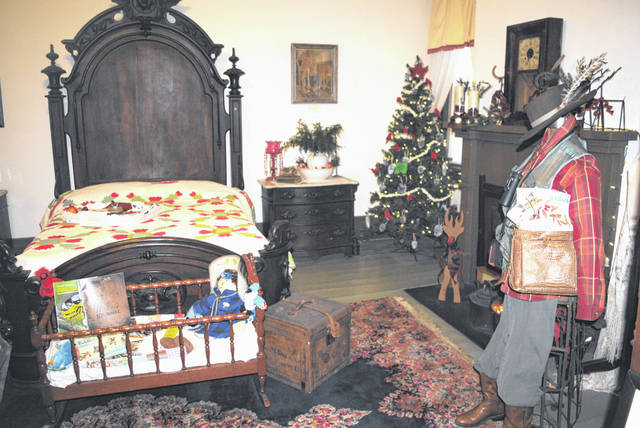 One of the 14 rooms in the Highland House Museum that are currently decorated for the holidays is shown in this photograph.