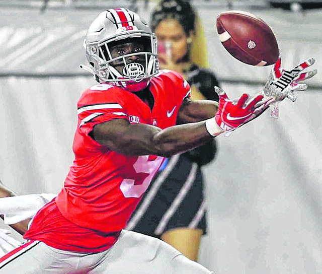 Ohio State #9 Binjimen Victor beats his man Indiana #14 Andre Brown Jr. and makes the catch for a late fourth quarter touchdown at Ohio Stadium on the campus of The Ohio State University October 6th 2018.
