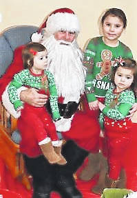 Tiny tots with their eyes all aglow take turns on Santa's lap during last year's Breakfast with Santa, sponsored by SATH. This year's event will take place Saturday, Dec. 8 at the Hopewell Center on W. New Market Rd.