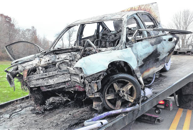 The burned-out wreckage of a 2004 Chevrolet Impala involved in a fatal accident earlier this week is shown being loaded onto a flat-bed truck.