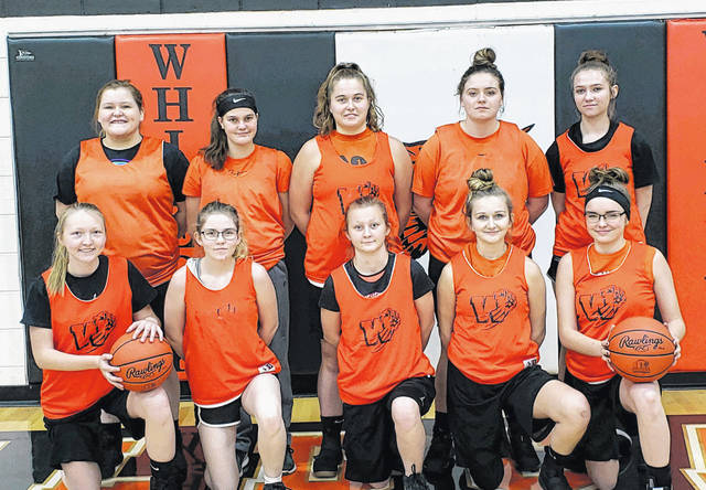 The Whiteoak Lady Wildcats varsity basketball team gathers for a team photo at Whiteoak High School following practice on Wednesday, Nov.14, in Mowrystown.