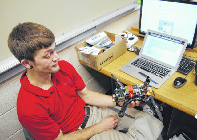 Holden Daugherty is shown with his homemade drone at Southern State Community College in Hillsboro.