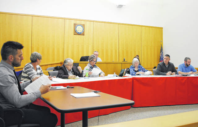 Shown from left are Hillsboro City Council members Justin Harsha, Mary Stanforth, Claudia Klein, Ann Morris, Wendy Culbreath, Brandon Leeth and Adam Wilkin. Also shown in the background is Council President Lee Koogler.